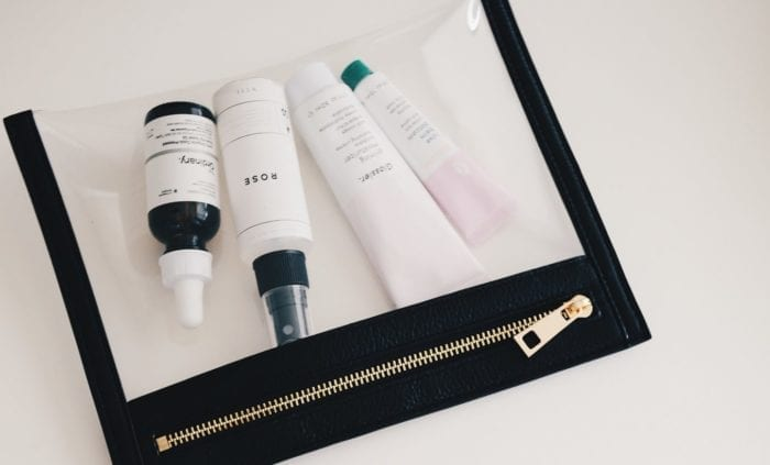 a clear makeup pouch with beauty products