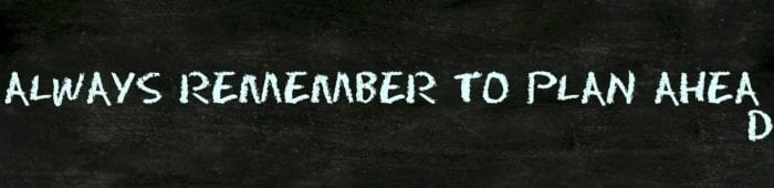 """Chalkboard background with the text, """"Remember to plan ahea"""" on one line and """"d"""" on the next"""