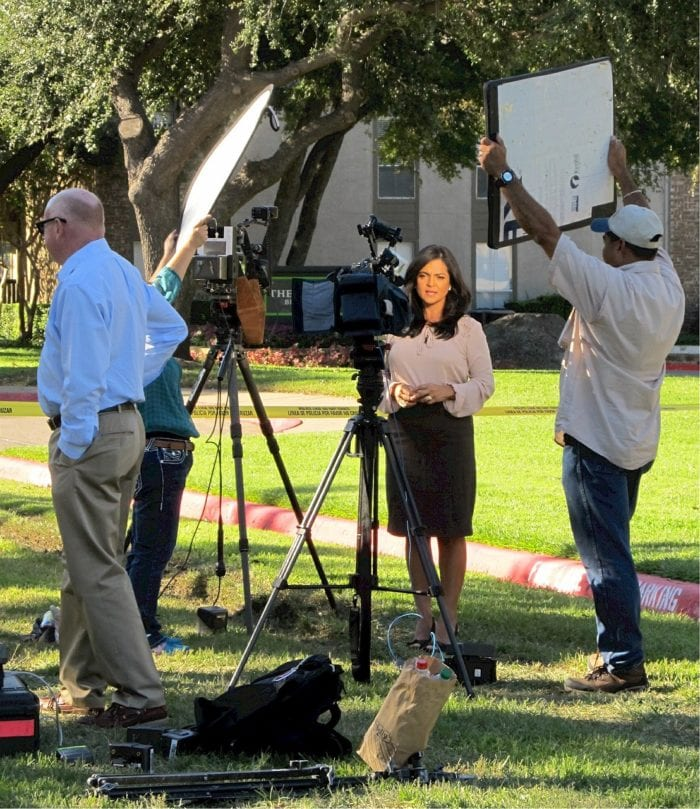 New reporter bringing news while news staff control sunlight and noise.