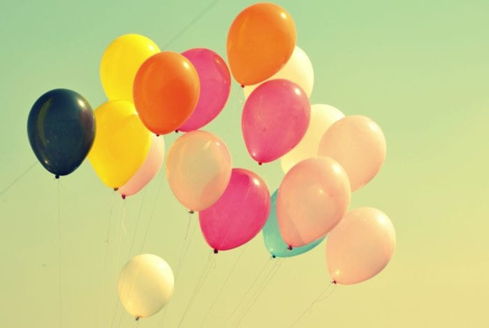 Several balloons on strings in the air