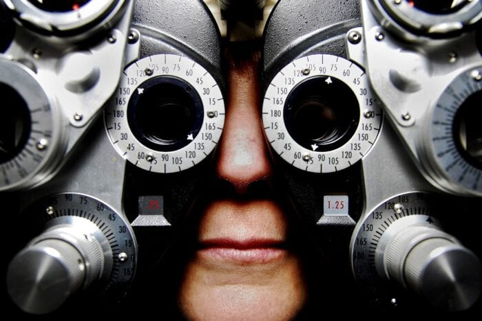 Nose and mouth of a person with their face in an eye exam machine