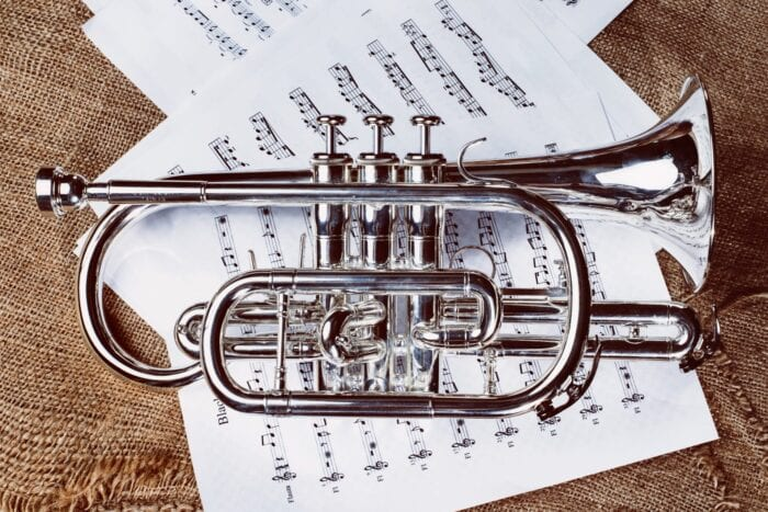 a trumpet on top of sheet music