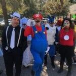 Several Braille Works team members wearing Halloween costumes