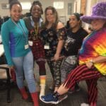 Five team members showing off their crazy socks