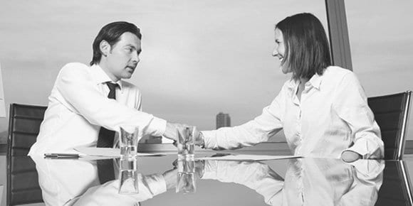 Image of a man and woman shaking hands in a financial setting