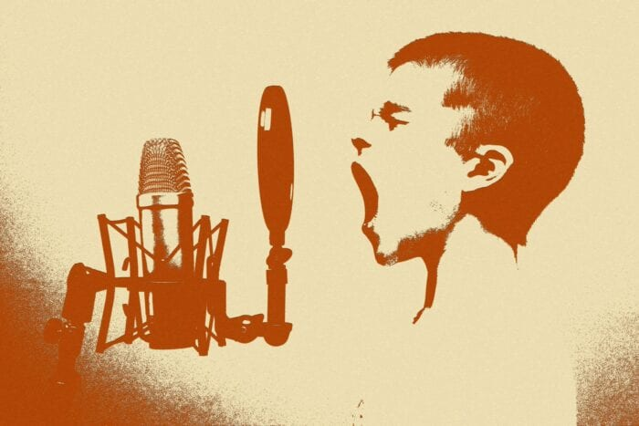 person yelling into a microphone
