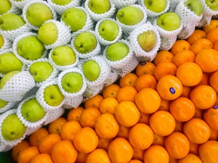 Several apples and oranges side by side