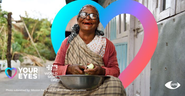 Women wearing glasses and smiling while peeling fruit in a bowl outside with the world sight day 2021 logo, love your eyes logo, and IAPB logo
